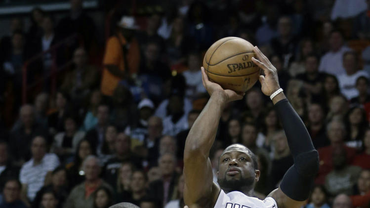 Miami Heat's Dwyane Wade (3) prepares to shoot over Memphis Grizzlies' Zach Randolph (50) in the first half of an NBA basketball game in Miami, Friday, March 1, 2013. (AP Photo/Alan Diaz)