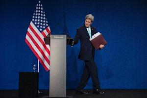 US Secretary of State John Kerry leaves after speaking …