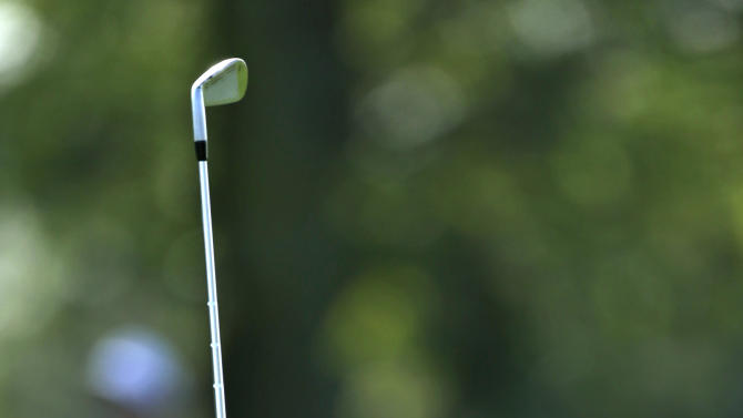 Bill Haas watches his shot from the 18th fairway to the green during the second round of the Arnold Palmer Invitational golf tournament, Friday, March 22, 2013, in Orlando, Fla. (AP Photo/John Raoux)