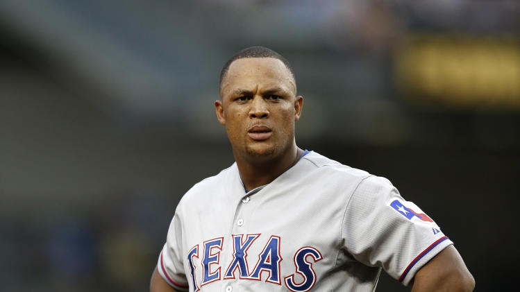 Texas Rangers Adrian Beltre waits for his fielding gear after a video review found teammate Alex Rios was caught stealing second in the first inning of a baseball game against the New York Yankees at Yankee Stadium in New York, Wednesday, July 23, 2014. (AP Photo)