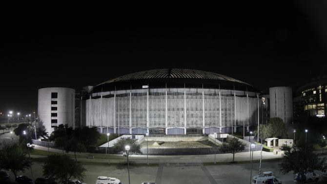 The Houston Astrodome is illuminated Tuesday, Nov. 5, 2013, in Houston. Houston-area voters are deciding whether to convert the Astrodome into a convention center or allow the iconic stadium to be demolished. (AP Photo/David J. Phillip)