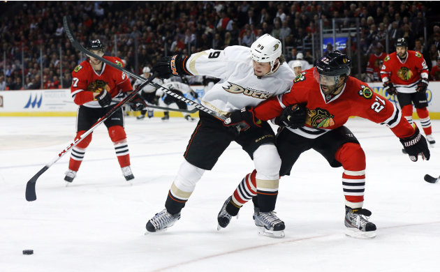 Chicago Blackhawks defenseman Johnny Oduya (27), of Sweden, pressures Anaheim Ducks left wing Matt Beleskey during the first period of an NHL hockey game, Tuesday, Feb. 12, 2013, in Chicago. (AP Photo