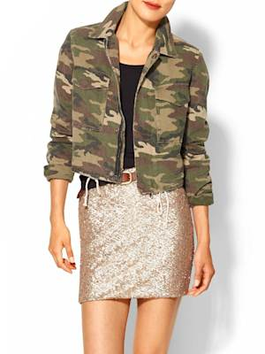 This product image released by Piperlime shows a camouflage cropped military jacket. The print that at one time was only a tool for military troops to go unnoticed has become a front-and-center look in fashion. It's been adapted in luxe fur, sequin sweaters, athletic wear and casual kicks. (AP Photo/Piperlime)