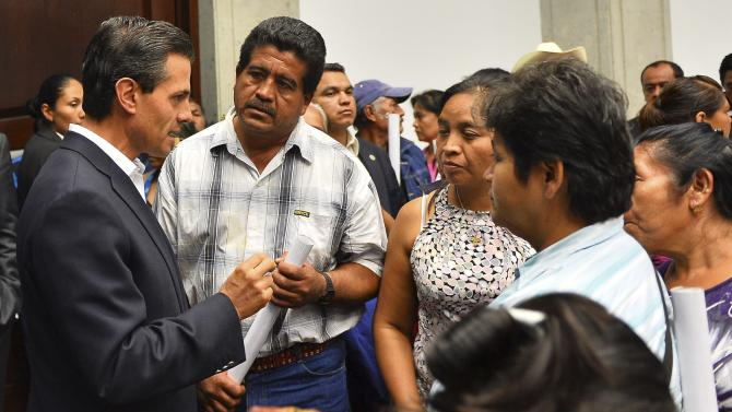 Handout photo of Mexico's President Pena Nieto talking to relatives of the 43 missing students of Ayotzinapa Teacher Training College in Mexico City