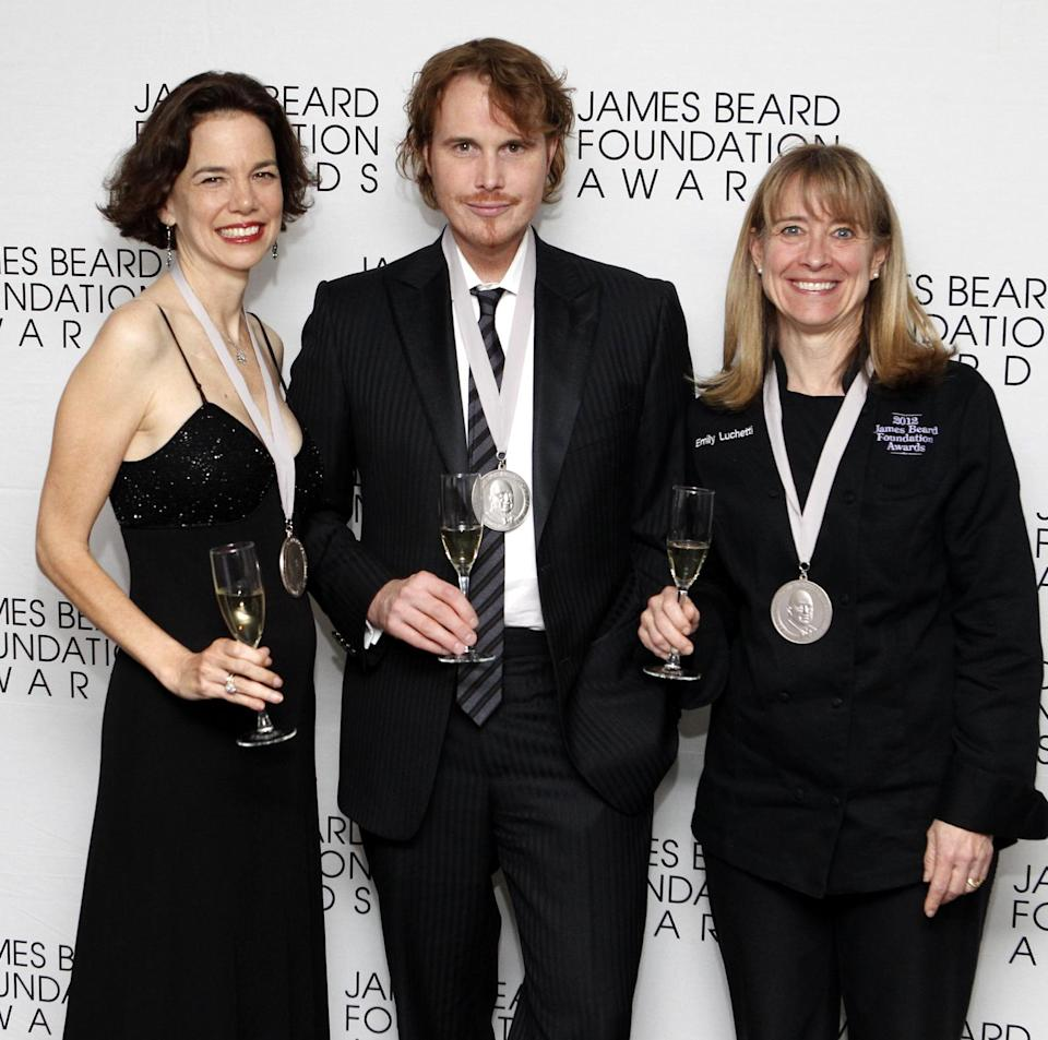 From left, journalist Dana Cowan, chef Grant Achatz and chef Emily Luchetti pose together after their Who's Who of Food & Beverage in America induction during the James Beard Foundation Awards, Monday, May 7, 2012, in New York. (AP Photo/Jason DeCrow)