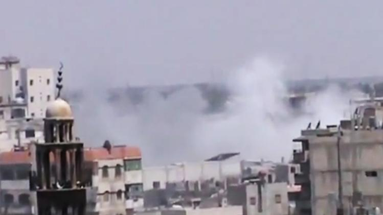 This image made from amateur video released by the Shaam News Network and accessed Thursday, June 21, 2012, purports to show smoke rising from buildings near a mosque in Homs, Syria. A spokeswoman for the International Committee of the Red Cross says aid workers teams will try to evacuate wounded and sick civilians and those who want to leave rebel-held areas in the embattled central Syrian city of Homs. (AP Photo/Shaam News Network via AP video) TV OUT, THE ASSOCIATED PRESS CANNOT INDEPENDENTLY VERIFY THE CONTENT, DATE, LOCATION OR AUTHENTICITY OF THIS MATERIAL