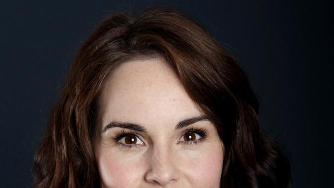 "Actress Michelle Dockery, from ""Downton Abbey"", poses for a portrait during the PBS TCA Press Tour on Saturday, July 21, 2012, in Beverly Hills, Calif. (Photo by Matt Sayles/Invision/AP)"