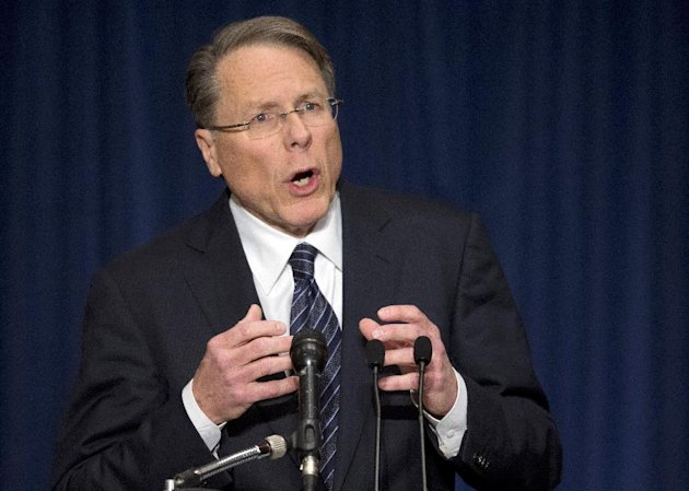 "The National Rifle Association executive vice president Wayne LaPierre, gestures during a news conference in response to the Connecticut school shooting on Friday, Dec. 21, 2012 in Washington. The nation's largest gun-rights lobby is calling for armed police officers to be posted in every American school to stop the next killer ""waiting in the wings."" (AP Photo/ Evan Vucci)"