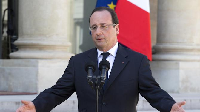 FILE - In this April 24, 2013 file photo, French President Francois Hollande talks to the media after the weekly cabinet meeting in Paris. The sounds of raucous protest echo in the Presidential Palace, unemployment among is rising inexorably, and his country's economy has been called a potential time bomb at the heart of Europe. Hollande, among the most unpopular French leaders in modern history, remains calm. (AP Photo/Jacques Brinon, File)