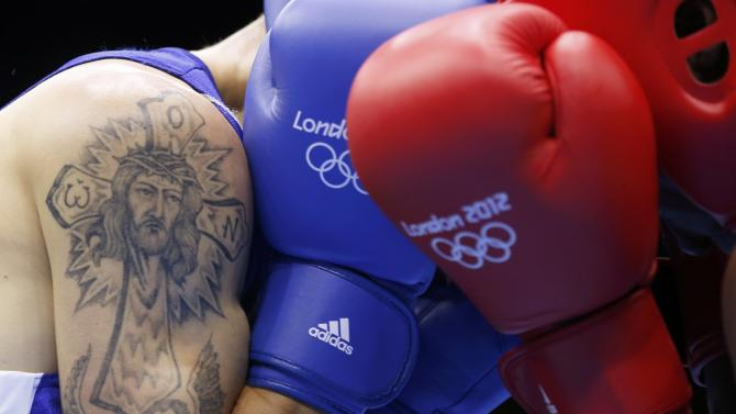 Moldova's Vasilii Belous (L) sports a tattoo as he fights against Tanzania's Selemani  Kidunda during the men's welter (69kg) Round of 32 boxing match at ExCeL venue during the London 2012 Olympic Games