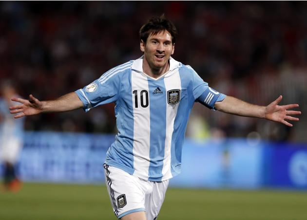 File photo shows Argentina's Messi celebrating after he scored his team's first goal against Chile during the 2014 World Cup qualifying soccer match in Santiago