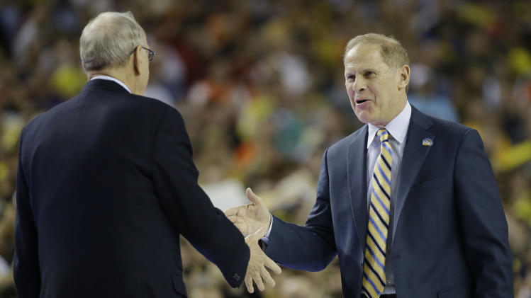Syracuse head coach Jim Boeheim, left, greets Michigan head coach John Beilein before the first half of the NCAA Final Four tournament college basketball semifinal game, Saturday, April 6, 2013, in Atlanta. (AP Photo/David J. Phillip)