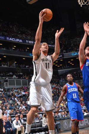 Lopez, Evans lead Nets past 76ers, 104-83