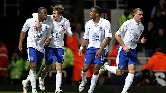 Everton&#39;s Victor Anichebe (left) celebrates scoring his teams first goal of the game with teammates (PA Sport)