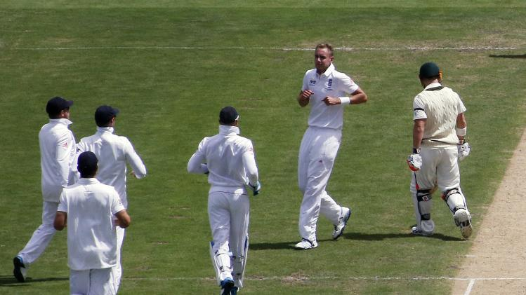 Teammates run to England's Broad after he dismissed Australia's Warner during the second Ashes test in Adelaide