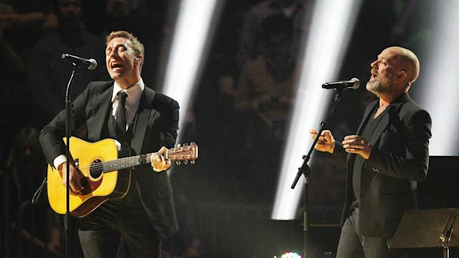 This image released by Starpix shows Chris Martin, left, and Michael Stipe at the 12-12-12 The Concert for Sandy Relief at Madison Square Garden in New York on Wednesday, Dec. 12, 2012. Proceeds from the show will be distributed through the Robin Hood Foundation. (AP Photo/Starpix, Dave Allocca)