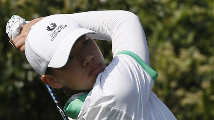 Guan of China tees off on 10th hole during first day of Hong Kong Open golf tournament