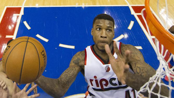 Portland Trail Blazers' Thomas Robinson goes up to shoot during the first half of an NBA basketball game against the Philadelphia 76ers, Saturday, Dec. 14, 2013, in Philadelphia. (AP Photo/Chris Szagola)
