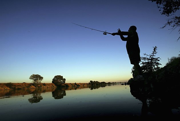 A fisherman casts his line (David McNew/Getty Images)