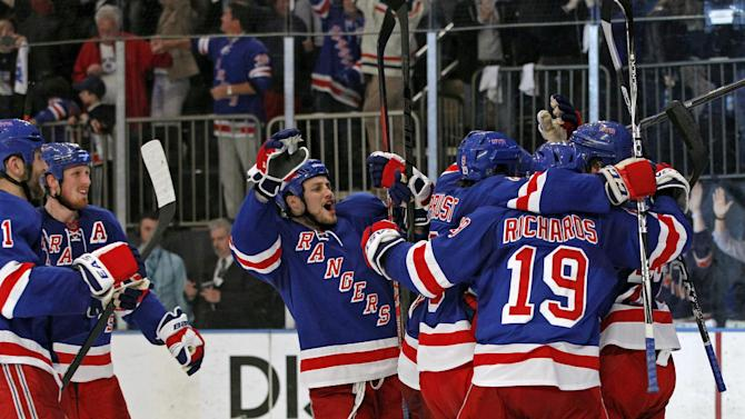New York Rangers players celebrate after defeating the Washington Capitals 2-1 in Game 7 of a second-round NHL hockey Stanley Cup playoff series at Madison Square Garden in New York, Saturday, May 12, 2012. The Rangers won the series 4-3. (AP Photo/Kathy Willens)