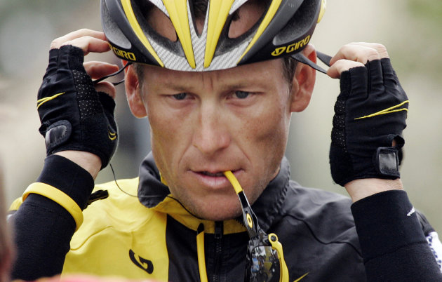 FILE - In this Feb. 22, 2009 file photo,  Lance Armstrong prepares for the final stage of the Tour of California cycling race in Rancho Bernardo, Calif.  The U.S. Anti-Doping Agency is bringing doping