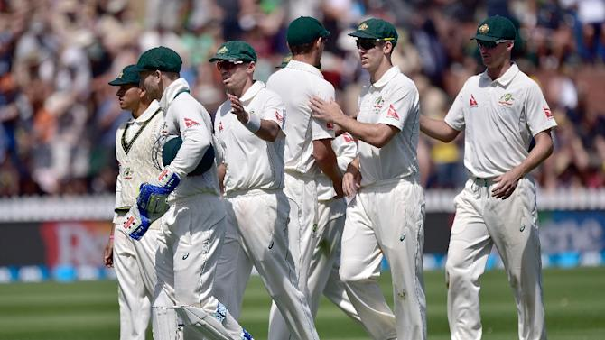 Australian players walk from the field at the end of the New Zealand innings during the first international five-day Test in Wellington on February 12, 2016