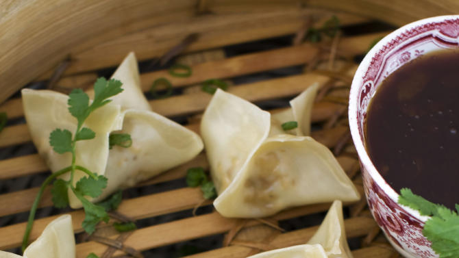 In this image taken on January 14, 2013, vegetarian steamed dumplings with sweet-and-sour sauce are shown in Concord, N.H. (AP Photo/Matthew Mead)