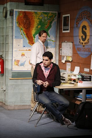 "This theater image released by Sam Rudy Media Relations shows Stephen Barker Turner as Dr. Danielson, and Babak Tafti as Khadim Asmaan, foreground, from The Vineyard Theatre's production, ""The North Pool."" (AP Photo/Sam Rudy Media Relations, Carol Rosegg)"