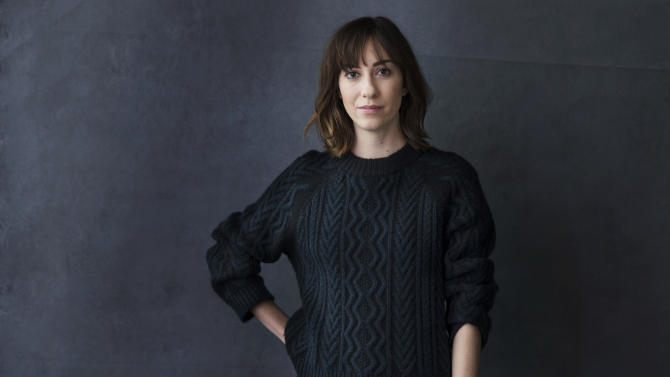 """In this Thursday, April 24, 2014 photo, writer-director Gia Coppola poses for a portrait in promotion of her film """"Palo Alto,"""" in New York. Getting Coppola, the granddaughter of Francis and niece of Sofia, to join the family business of filmmaking was a hard sell. """"I didn't feel pressure from my family,"""" says the soft-spoken 27-year-old, whose first film """"Palo Alto"""" opened last weekend. """"I felt outsiders were always asking me if I was going into film and it deterred me. It felt intimidating to have that kind of attention."""" (Photo by Victoria Will/Invision/AP)"""