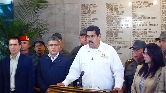 In this photo released by Miraflores Presidential Press Office, Venezuela's Vice President Nicolas Maduro addresses the nation to announce the death of President Hugo Chavez in Caracas, Venezuela, Tuesday, March 5, 2013. Maduro announced that Chavez has died on Tuesday at age 58 after a nearly two-year bout with cancer. (AP Photo/Miraflores Presidential Press Office)