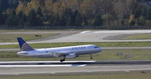 A United Airlines plane makes a landing Monday, Oct.…