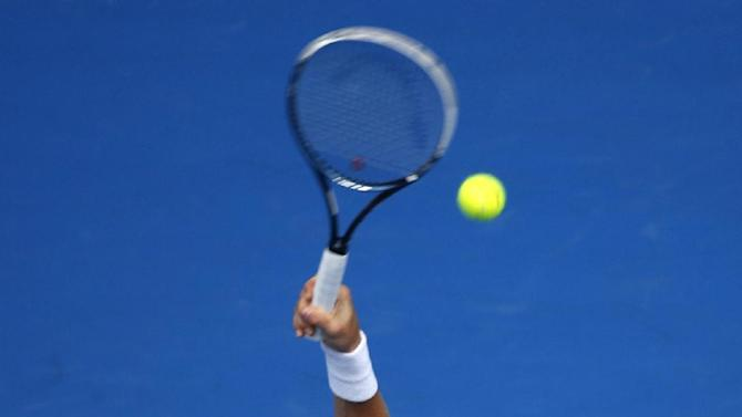 Tomas Berdych of the Czech Republic serves to Rafael Nadal of Spain  during their quarterfinal match at the Australian Open tennis championship in Melbourne, Australia, Tuesday, Jan. 27, 2015. (AP Photo/Vincent Thian)
