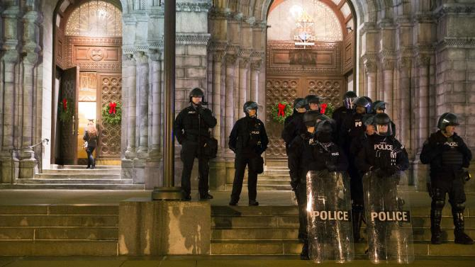 Police stand guard during a protest at Cathedral Basilica, after a man was fatally shot by a policeman, in St. Louis