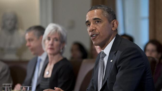 President Barack Obama speaks to the media before meeting his Cabinet meeting, Tuesday, Jan. 14, 2014, in the Cabinet Room of the White House in Washington. From left are, Education Secretary Arne Duncan, and Health and Human Services Secretary Kathleen Sebelius. (AP Photo/Carolyn Kaster)