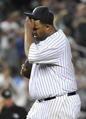New York Yankees starting pitcher CC Sabathia wipes his brows after Seattle Mariners' Brendan Ryan hit a single to break up a perfect game in the seventh inning of a baseball game Tuesday, July 26, 2011, at Yankee Stadium in New York. (AP Photo/Kathy Kmonicek)
