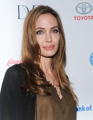 Actress Angelina Jolie attends the 4th Annual Women in the World Summit at the David H. Koch Theater on Thursday April 4, 2013 in New York. (Photo by Evan Agostini/Invision/AP)