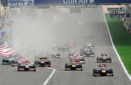 Red Bull Racing's German driver Sebastian Vettel leads (R) after the start at the Bahrain international circuit in Manama during the Bahrain Formula One Grand Prix. Bahrain's controversial Grand Prix race went off without incident on Sunday after a week of angry protests away from the F1 desert circuit that put the non-sporting focus on reform demands in the Gulf state