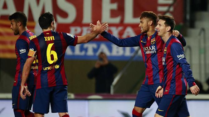 Barcelona's Brazilian forward Neymar celebrates his second goal with Lionel Messi and Xavi Hernandez (L) during the Spanish league football match Elche FC vs FC Barcelona at the Martinez Valero stadium in Elche on January 24, 2015