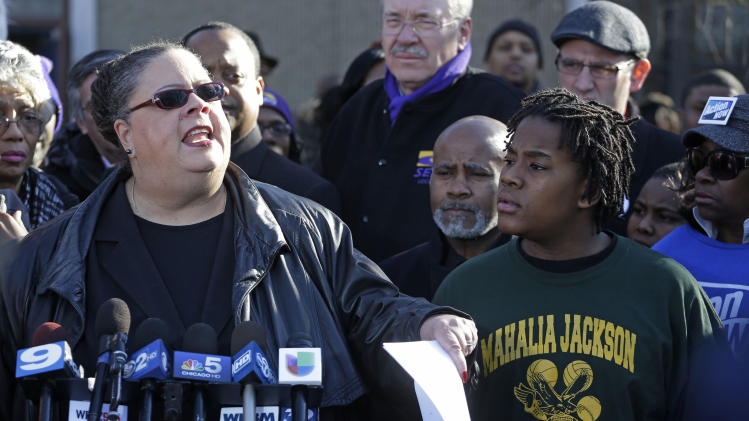 Chicago Teachers Union President Karen Lewis speaks outside the Mahalia Jackson Elementary School in Chicago, Thursday, March 21, 2013, about the planned closing of public schools. The city of Chicago began informing teachers, principals and local officials Thursday about which public schools it intends to close under a contentious plan that opponents say will disproportionately affect minority students in the nation's third largest school district. (AP Photo/M. Spencer Green)