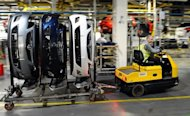Parts for Vauxhall and Opel Astra cars are transported on the production line at the Vauxhall factory in Ellesmere Port, north-west England. The Bank of England on Wednesday cut its forecast for UK economic growth next year to about 1% owing to the sovereign debt crisis in the neighbouring eurozone