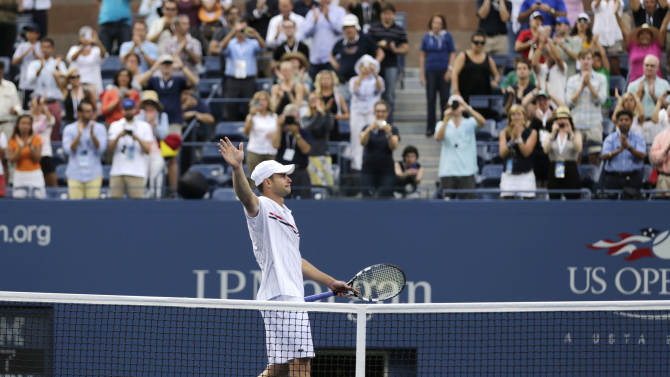 Andy Roddick waves to fans after his fourth round loss to Argentina's Juan Martin Del Potro at the 2012 US Open tennis tournament, Wednesday, Sept. 5, 2012, in New York. Roddick said he would retire after the match. (AP Photo/Charles Krupa)