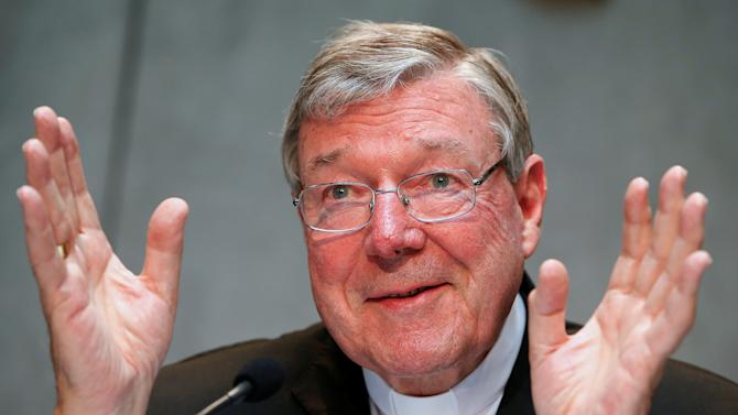 File photo of Cardinal George Pell gesturing as he talks during a news conference for the presentation of new president of Vatican Bank IOR, at the Vatican