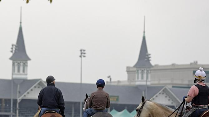 Trainer D. Wayne Lukas walks with Kentucky Derby entrant Oxbow and jockey Gary Stevens before a workout at Churchill Downs Monday, April 29, 2013, in Louisville, Ky. (AP Photo/Charlie Riedel)