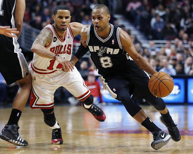 San Antonio Spurs Patty Mills (8) pushes past Chicago Bulls D.J. Augustin (14) during the first half of an NBA basketball game on Tuesday, March 11, 2014, in Chicago. The San Antonio Spurs defeated Th