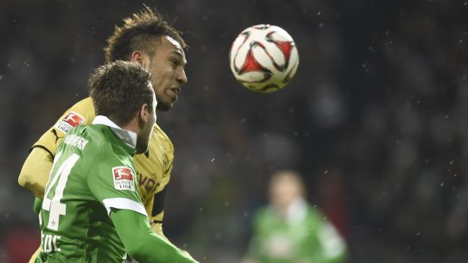 Borussia Dortmund's Aubameyang and Werder Bremen's Bargfrede fight for the ball during their German Bundesliga first division soccer match in Bremen