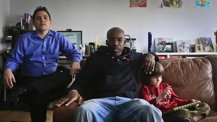 "Jonathan Fleming, center, who was exonerated of murder after almost 25 years behind bars, visits his lawyer Taylor Koss, left,  and his son Max, 6, on Friday April 18, 2014 in New York. The weeks since his release have been a mix of emotional highs and practical frustrations.  ""Coming back, you know, it's been hard. ... It's a lot to have to catch up on.""  (AP Photo/Bebeto Matthews)"