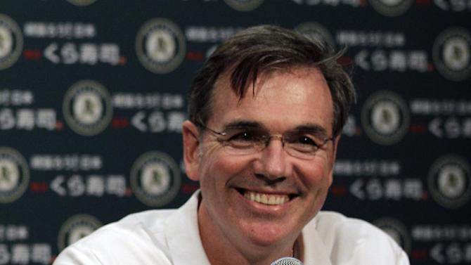 Oakland Athletics general manager Billy Beane smiles during a media conference Wednesday, Sept. 21, 2011, in Oakland, Calif. The Oakland Athletics have reached agreement on a three-year contract to keep Bob Melvin as their permanent manager. The 49-year-old Melvin took over in an interim capacity for the fired Bob Geren in June and has a 42-49 record after Tuesday night's 7-2 loss to the AL West-leading Texas Rangers at the Coliseum. Geren's dismissal marked the first time Oakland fired a manager during the season in a quarter century. (AP Photo/Ben Margot)