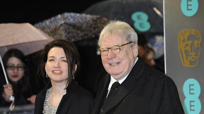 """Lisa Parker, left, and director Alan Parker arrive for the BAFTA Film Awards at the Royal Opera House on Sunday, Feb. 10, 2013, in London. Alan Parker, who has directed films including """"Evita,""""  """"Bugsy Malone"""" and """"Mississippi Burning,"""" will be honored with the Bafta Fellowship award. (Photo by Jonathan Short/Invision/AP)"""