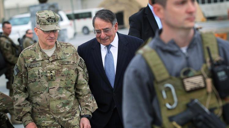 Defense Secretary Leon Panetta talks with Lt. Gen. Curtis Scaparrotti in Kabul, Afghanistan, Thursday, March 15, 2012, before leaving for United Arab Emirates.  (AP Photo/Scott Olson, Pool)