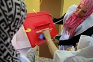 A Libyan woman casts her ballot at a school turned polling station in the western city of Misrata during Libya's General National Congress election in July 2012. Libyans cast ballots on July 7 in their first free election since a popular uprising last year that escalated into a civil war and ousted the regime of now slain dictator Kadhafi